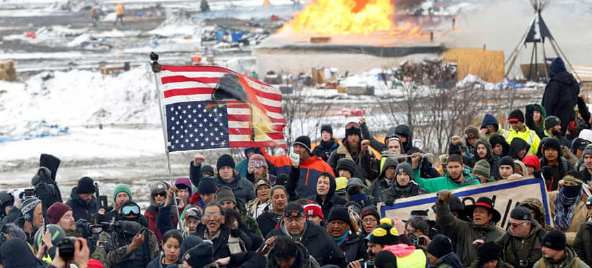 Opponents of the Dakota Access oil pipeline march out of their main camp near Cannon Ball, North Dakota, in February 2017. (photo: Terray Sylvester/Reuters)