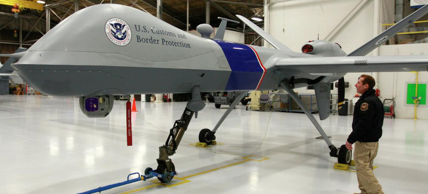 Max Raterman, Director of Air Operations, inspects an MQ9 Predator drone. (photo: Eric Hylden/Grand Forks Herald)