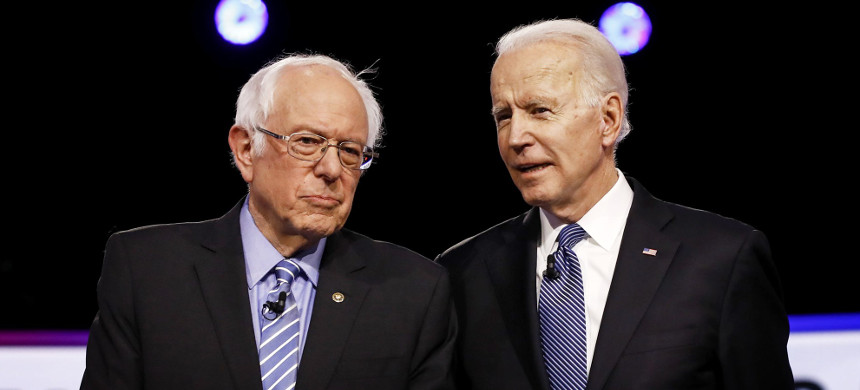 Sen. Bernie Sanders and Joe Biden before a Democratic presidential primary debate in Charleston, S.C., on Feb. 25, 2020. (photo: Matt Rourke/AP)
