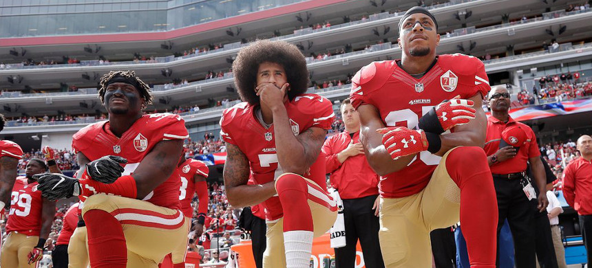 The National Football League did not support (from left) Eli Harold, Colin Kaepernick, Eric Reid and other players who kneeled during the playing of the national anthem in 2016 to protest racial injustice. (photo: Mario Jose Sanchez/AP)