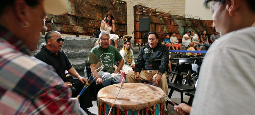 Members of the Yellow Hammer Native American drum band from Ponca City, Oklahoma, play a song for Native American dancers inside the  National Museum of the American Indian in Washington, D.C. (photo: Getty)