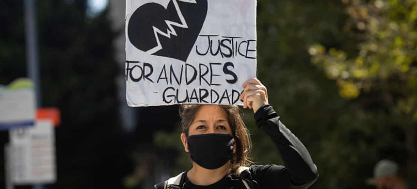 A demonstrator holds a sign demanding justice for Andres Guardado in Los Angeles, California, on 8 July. (photo: Christian Monterrosa/EPA)