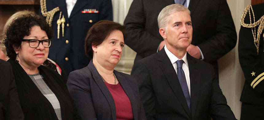 Supreme Court associate justices (L-R) Sonia Sotomayor, Elena Kagan, and Neil Gorsuch attend the swearing in ceremony for newly confirmed Associate Justice Brett Kavanaugh in the East Room of the White House on October 8, 2018, in Washington, DC. (photo: Chip Somodevilla/Getty Images)