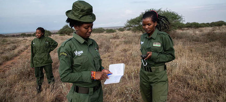 Sharon Nankinyi, centre, on patrol with Purity Amleset, right, of the International Fund for Animal Welfare's Team Lioness. (photo: Georgina Smith/Guardian UK)