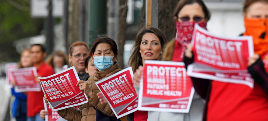 Nurses at a rally to protest the lack of coronavirus supplies at a hospital. (photo: Jose Carlos Fajardo/Bay Area News Group)
