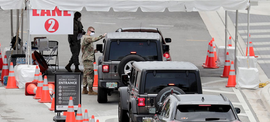 Florida National Guard personnel direct vehicles at a coronavirus testing site at the Miami Beach Convention Center. (photo: Lynne Sladky/AP)