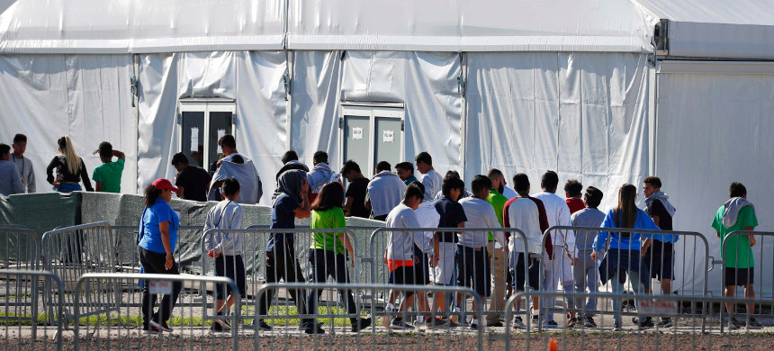 Detained migrant children from Central America line up to enter a tent at the Homestead Temporary Shelter for Unaccompanied Children in Homestead, Florida, Feb. 19, 2019. (photo: AP)