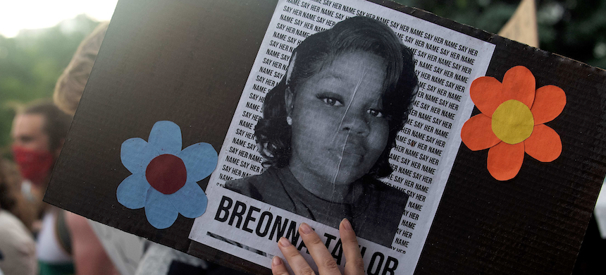 A demonstrator holds a sign with the image of Breonna Taylor. (photo: Jason Connolly/AFP/Getty Images)