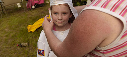 A child is fitted for a new Klan robe, 12/10/09. (photo: Anthony Karen)