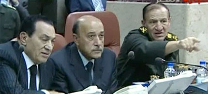 In this still image taken from video, Egypt's President Hosni Mubarak (left) and Vice President Omar Suleiman (center) hold a cabinet meeting in Cairo, January 30, 2011. (photo: Reuters)