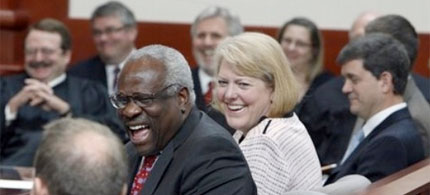 Clarence and Virginia Thomas share a good laugh with attendees at a Utah Supreme Court swearing-in ceremony, 07/19/10. (photo: AP)