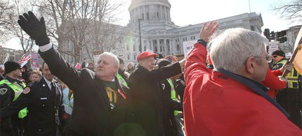 The 'Wisconsin 14' democratic state senators return to a hero's welcome at the capitol in Madison, Wisconsin, 03/13/11. (photo: Scott Olson/Getty Images)