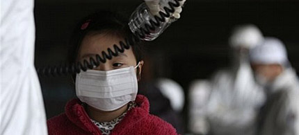 A young girl is screened for radiation at a shelter for those evacuated from areas around the damaged Fukushima nuclear plant, 03/24/11. (photo: Wally Santana/AP)