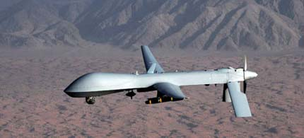 Precision targeting provided by unmanned drones has become a favored strike weapon in Afghanistan, and could help NATO pinpoint Gaddafi forces in Libya. (photo: Rex Features/Sipa Press)