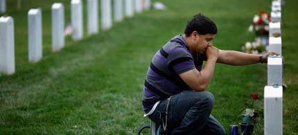 Ricky Parada visits the grave of his brother, US Marine Corporal Nicholas Rodriguez, at Arlington National Cemetery after news of Osama bin Laden's death, 05/03/11. (photo: Chip Somodevilla/Getty Images)