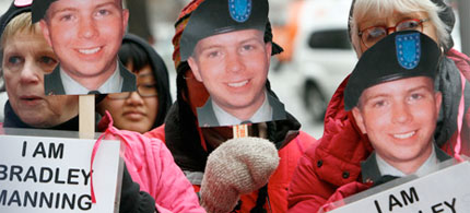 Protesters display 'I Am Bradley Manning' posters at a rally in support of Manning. (photo: Jacquelyn Martin/AP)