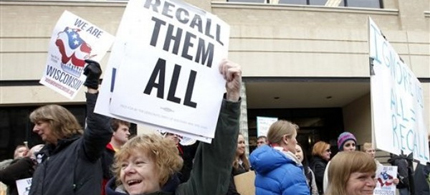 Protesters in Wisconsin display 'Recall Them All' posters. (photo: AP)