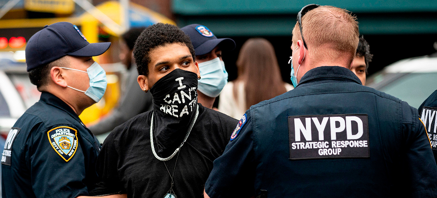 NYPD officers arrest a protestor during a 'Black Lives Matter' demonstration on May 28, in New York City. (photo: Johannes Eisele/Getty)