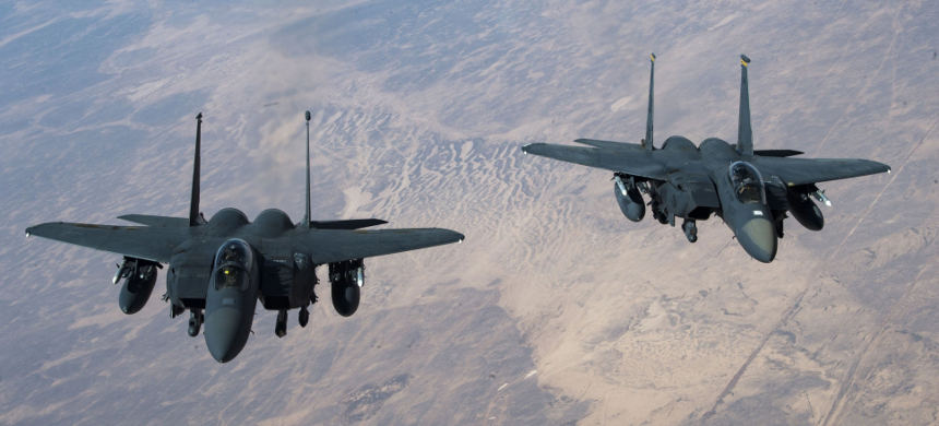 Two U.S. Air Force F-15 Strike Eagles fly in formation over an undisclosed location on October 10, 2019. (photo: U.S. Air Force)