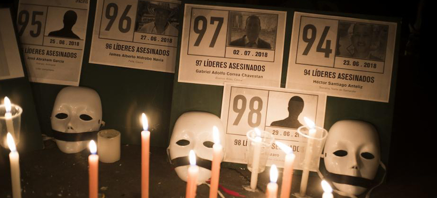 Photos of activists killed in Colombia. (photo: D. Garzon Herazo/NurPhoto)