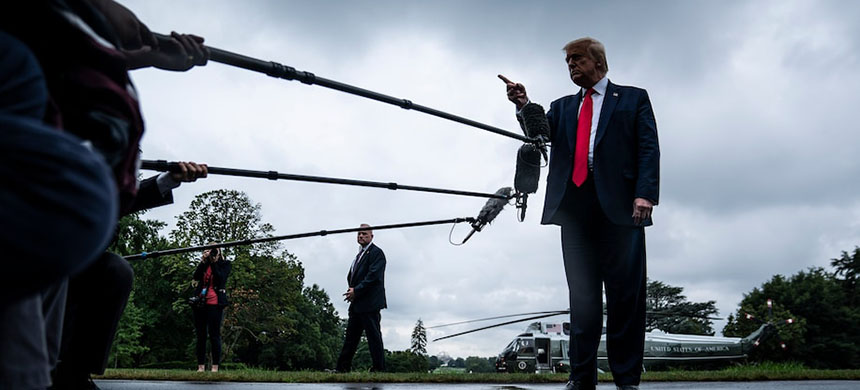President Trump stops to talk to reporters as he walks to board Marine One and depart from the South Lawn at the White House on July 31. (Jabin Botsford/WP)