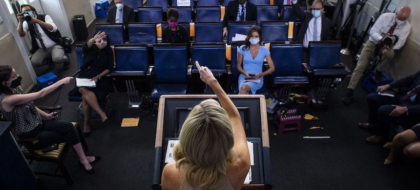 White House press secretary Kayleigh McEnany takes questions from journalists who are wearing masks and practicing social distancing at the White House. (photo: Jabin Botsford/WP)