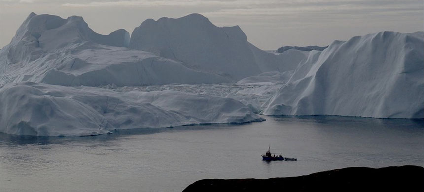 A fishing vessel sails in the ice fjord near Ilulissat, Greenland September 12, 2017. Picture taken September 12, 2017. (photo: Jacob Gronholt-Pedersen/Reuters)
