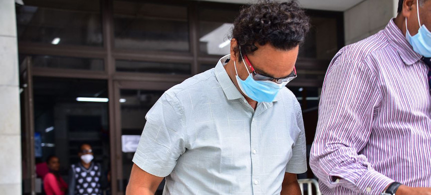 The captain of the vessel behind a devastating Mauritius oil spill left court after being charged Tuesday. (photo: Rishi Etwaroo/Getty)