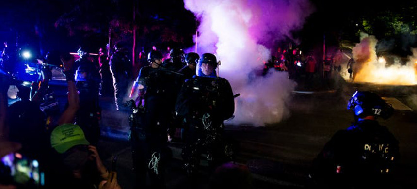 Police deploy smoke canisters in Portland. (photo: Dave Killen/The Oregonian)