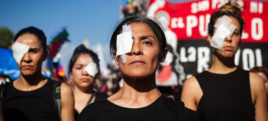 Activists in Santiago, Chile, hold a protest in solidarity with the people who were shot in their eyes. (photo: Federico Rotter/NurPhoto/PA Images)