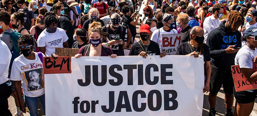 Protesters march with the family of Jacob Blake during a rally against racism and police brutality in Kenosha, Wisconsin, on August 29, 2020. (photo: Stephen Maturen/AFP/Getty Images)
