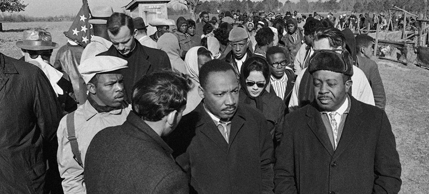 Martin Luther King Jr., center flanked by John Lewis to his right and Ralph D. Abernathy to his left march near Selma, Alabama on March 22, 1965. (photo: Anonymous/AP)