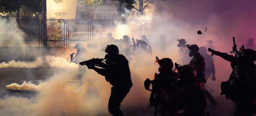 Police use of tear gas during protests in Portland. (photo: AP)