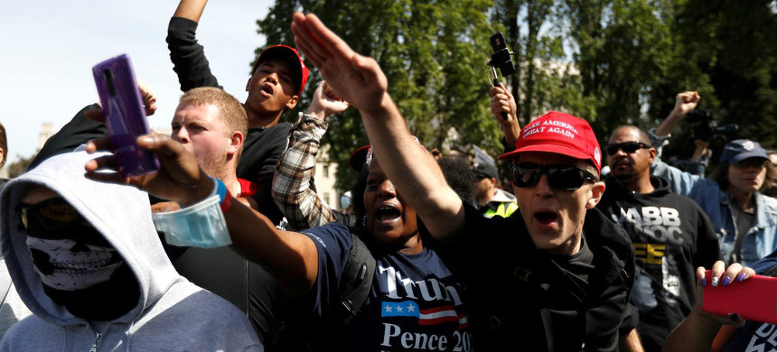 Supporters of President Donald Trump attend a rally and car parade Saturday, Aug. 29, 2020, in Clackamas, Oregon, on the way to Portland. (photo: AP)
