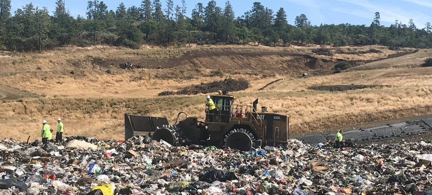 Landfill workers bury all plastic except soda bottles and milk jugs at Rogue Disposal & Recycling in southern Oregon. (photo: Laura Sullivan/NPR)