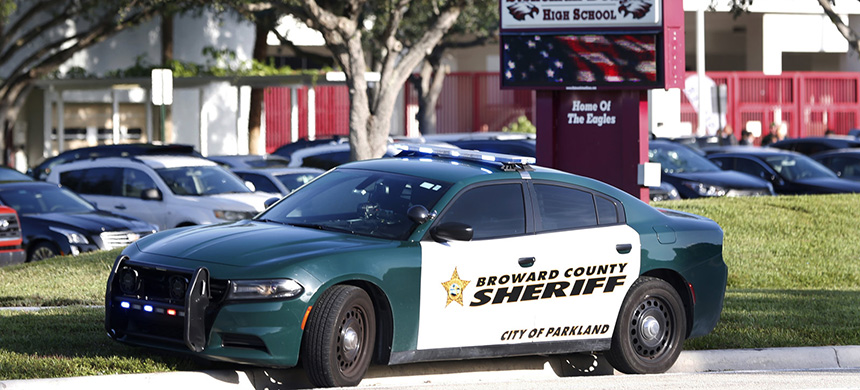 A Broward County Sheriff's Office vehicle is parked outside Marjory Stoneman Douglas High School, in Parkland, Florida. (photo: Wilfredo Lee/AP)