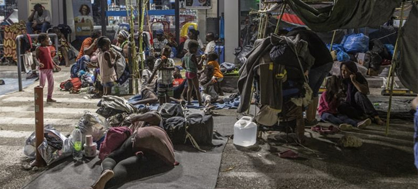 Asylum seekers previously living in the Moria camp on Lesbos are now sleeping rough in front of a Greek supermarket in improvised shelters. (photo: Anna Pantelia/Al Jazeera)