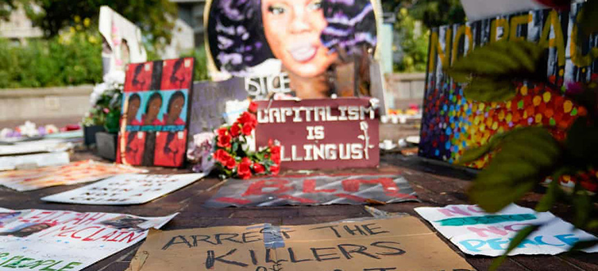 Signs used during protests and rallies are gathered around a memorial for Breonna Taylor in Louisville, Kentucky. (photo: Bryan Woolston/Reuters)