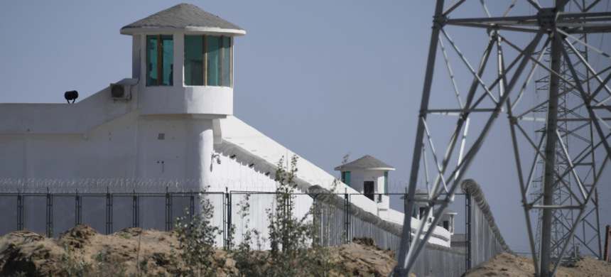 Watchtowers at a high-security facility near what is believed to be a re-education camp on the outskirts of Hotan, in China's northwestern Xinjiang region. (photo: Greg Baker/AFP)