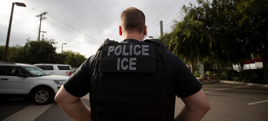 An Immigration and Customs Enforcement officer during an operation last year in Escondido, Calif. (photo: Gregory Bull/AP)