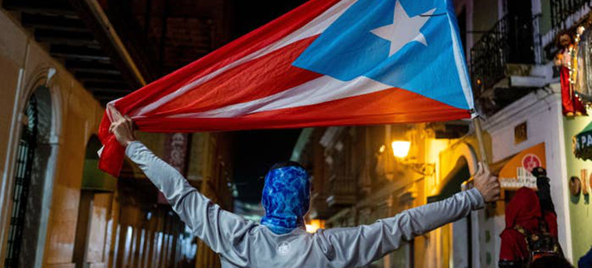 Puerto Ricans protest on January 23, 2020, after a warehouse full of relief supplies, reportedly dating back to Hurricane Maria in 2017, were found having been left undistributed to those in need. (photo: Ricardo Arduengo/Getty)