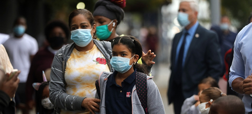 New York City students attend school during the pandemic. The Trump administration has been pushing for schools to reopen for in-person education. (photo: Spencer Platt/Getty Images)
