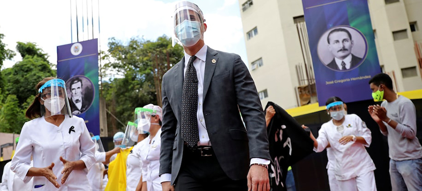 Venezuelan opposition leader Juan Guaidó takes part in a gathering with health-care workers Thursday in Caracas. (photo: Manaure Quintero/Reuters)