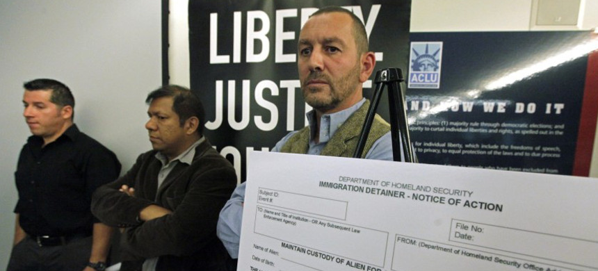 British filmmaker Duncan Roy, right, in 2012 announces a lawsuit by the American Civil Liberties Union on behalf of arrestees who said they were improperly denied bail because of federal immigration holds.  (photo: Reed Saxon/AP)