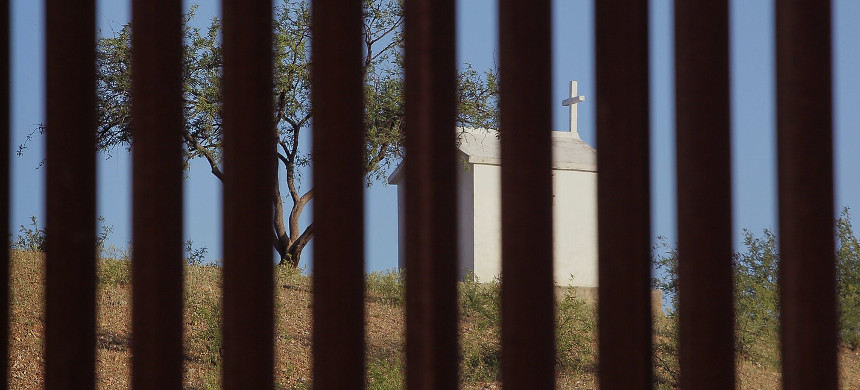 A shrine sits in Mexico near the massive border fence erected by the United States to deter illegal immigration near Sasabe, Arizona, on June 1, 2010. (photo: Scott Olson/Getty)