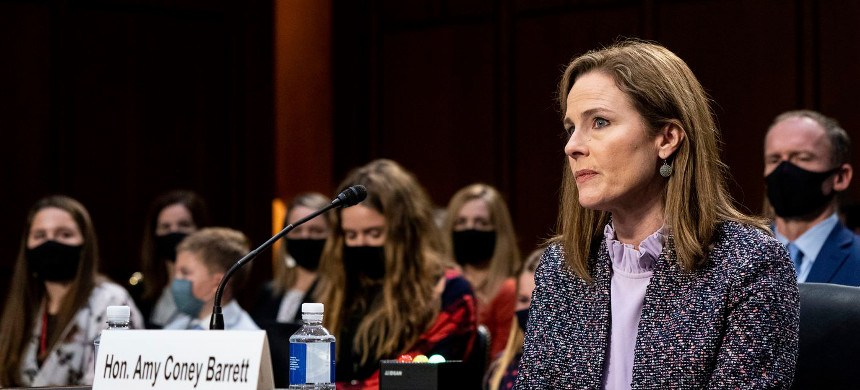 Supreme Court nominee Amy Coney Barrett listens during a confirmation hearing before the Senate Judiciary Committee, Wednesday, Oct. 14, 2020, on Capitol Hill in Washington. (photo: Erin Schaff/AP)