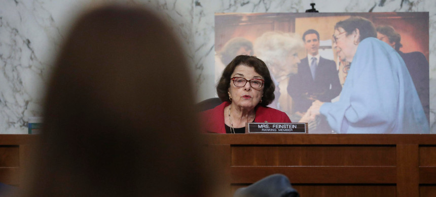 Senate Judiciary Committee Ranking Member Sen. Dianne Feinstein, D-CA, questions Supreme Court Justice nominee Judge Amy Coney Barrett on the second day of her confirmation hearings on Capitol Hill on Tuesday. (photo: Leah Millis/Getty)