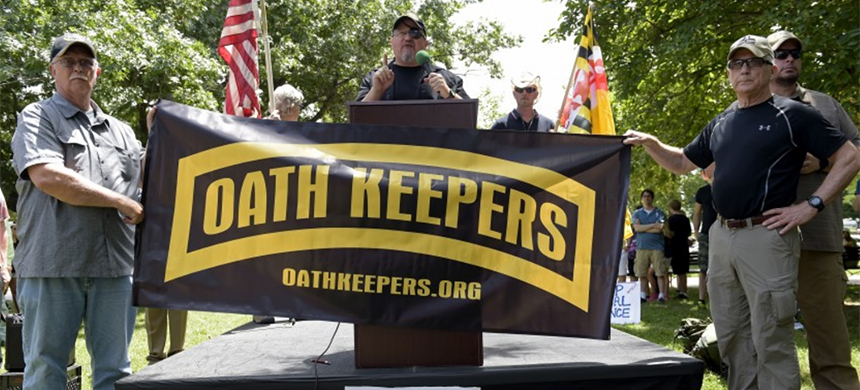 Oath Keepers founder Stewart Rhodes, center, speaks during a rally outside the White House in 2017. (photo: Susan Walsh/AP)