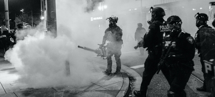 Federal agents deploy tear gas in the neighborhood near the Immigration and Customs Enforcement building in Portland, Ore., on Oct. 17, 2020. (photo: Doug Brown/ACLU Oregon)