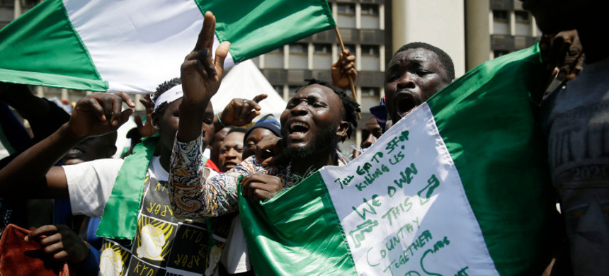 People protesting against police brutality in Lagos on October 20. (photo: Sunday Alamba/AP)